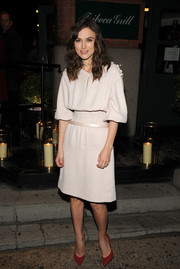 Keira Knight added a pop of rich color with a pair of red Bionda Castana pumps.