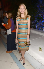Lauren looked sophisticated with a twist in this striped sheath dress at the Chanel benefit.