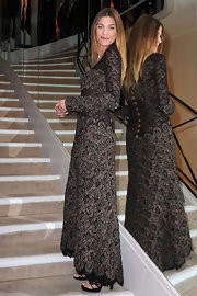 Elisa wears a floor length textured gown with sheer patterned insets for the Chanel dinner party in Paris.