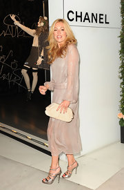 Cat Deeley looked Chanel chic at the brand's soiree in LA. She topped off her look with metallic silver strappy sandals.