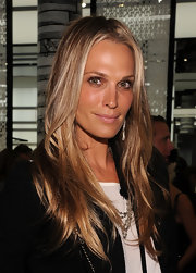 Molly Sims showed off her long straight locks while hitting the Chanel re-opening.