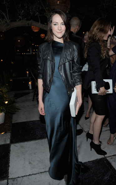 Jena Malone toughened up her dress with a black leather moto jacket.