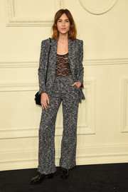 Alexa Chung went the androgynous route in a gray tweed pantsuit by Chanel during the brand's Paris-Salzburg show.
