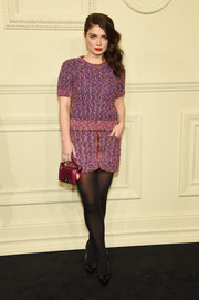 Eve Hewson was laid-back yet chic in a pink and blue tweed mini by Chanel during the label's Paris-Salzburg show.