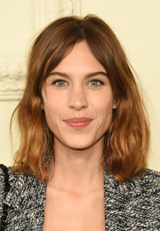 Alexa Chung rocked a messy-wavy 'do at the Chanel Paris-Salzburg show.