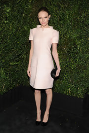 Kate Bosworth topped off her all-Chanel ensemble with a geometric black satin clutch.