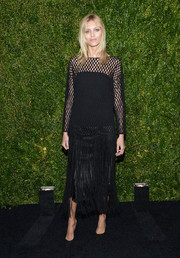 Anja Rubik went for edgy sophistication with this black mesh-and-fringe dress by The Row during the Tribeca Film Festival Artists Dinner.