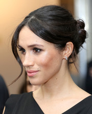 Meghan Markle accessorized with a pair of delicate diamond earrings by Birks.