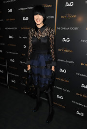 Agyness paired her black tights with a lace embellished cocktail dress.