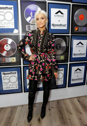 Ashlee Simpson injected major edge with a pair of thigh-high leather boots.