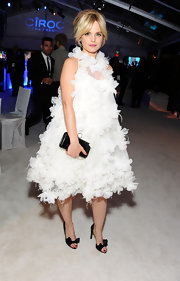 Mena Suvari was a frothy beauty in this extravagant dress at the Elton John Oscar viewing party.