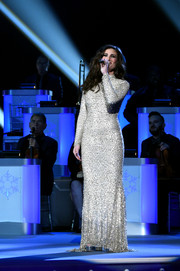 Idina Menzel looked radiant in a silver sequin gown by Gomez-Gracia while performing at the CMA 2016 Country Christmas.