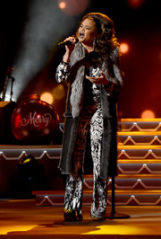Andra Day glammed up a printed jumpsuit with a gray fur coat for her CMA 2016 Country Christmas performance.