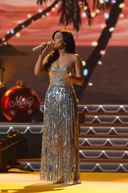Kacey Musgraves was all aglitter in a beaded strapless dress with a fringe skirt while performing at the CMA 2016 Country Christmas.