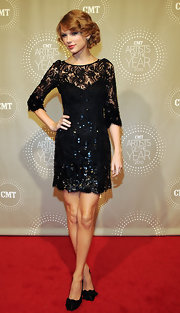 Taylor sparkles in a breathtaking beaded lace gown on the CMT Artists of the Year red carpet. The Jenny Packham design is just Taylor's style!