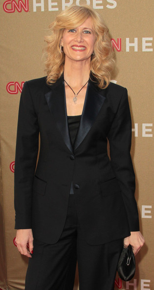 Laura Dern matched her satin lapels to a petite black frame clutch.