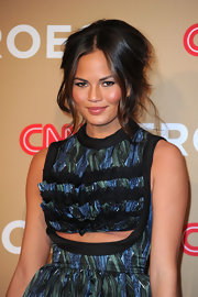 Christine Teigen rocked a loose updo with a chic center part while attending the CNN Heroes event.