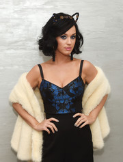 Katy Perry attended the CoverGirl Katy Kat event wearing a luxurious cream-colored fur scarf.