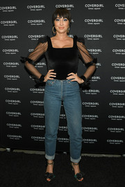 Jackie Cruz attended the CoverGirl flagship store opening wearing a fitted black top with sheer sleeves.