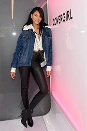 Chanel Iman layered a loose denim jacket over a crop-top for the CoverGirl flagship store opening.