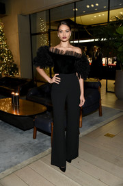 Shanina Shaik paired her top with black wide-leg trousers.