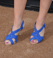 Marg's strappy braided sandals matched the purple blue hue of her dress.