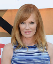 Marg's strawberry blonde locks looked no-fuss chic with a straight cut with side-swept bangs.