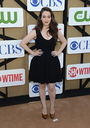 Kat Dennings opted for a pair of brown patent platform pumps to team with her dress.