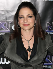 Gloria Estefan arrived at The CW event celebrating 'The Next' in a sleek half up half down hairdo.