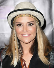 Brooke Mueller channeled her inner-hippie in a woven straw hat that was made complete with a feathered headband.