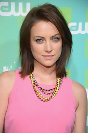 Jessica Stroup attended the CW 2012 Upfront event wearing a neon multi-chain necklace.