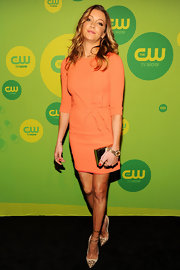 Katie Cassidy rocked an orange frock with a ruched waist at the CW Upfront event.