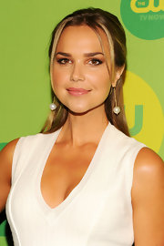 Arielle Kebbel chose a classic half up, half down 'do for her look at CW's Upfront Event.
