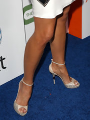 Kelly completed her classic look with snakeskin, ankle-strap sandals featuring a cool sphere detailing on the heels.