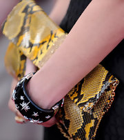 Dina Manzo showed off an embellished bangle bracelet that was all too eye-catching when paired with her snakeskin clutch.