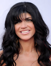 Housewife Teresa Giudice showed off her long curls while walking the carpet at an L.A. event. She added a subtle red streak that was less than flattering.