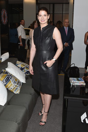 Debra Messing donned a stylish button-front leather dress for the grand opening of Cadillac House.