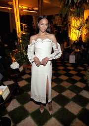 Zoe Saldana looked darling in a cream-colored Jonathan Simkhai leather dress, featuring ruffled lace-up sleeves and a studded hem, during Cadillac's Oscar week celebration.