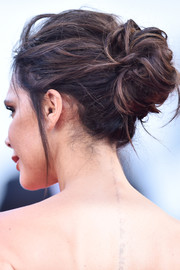 Victoria Beckham attended the Cannes opening gala wearing her hair in a messy-sexy bun.