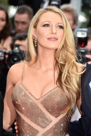 Blake Lively wore her long tresses down with bouncy waves during the Cannes opening gala.