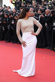 Eva Longoria was classic and chic in a long-sleeve nude and white Pamella Roland gown at the Cannes opening gala.