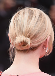 Kirsten Dunst sported a simple loose bun at the Cannes opening gala.