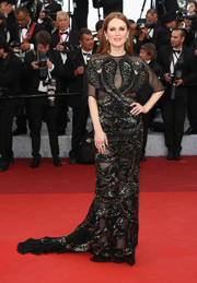 Julianne Moore looked fierce in a cobra-sequined, sheer-panel gown by Givenchy Couture at the Cannes opening gala.