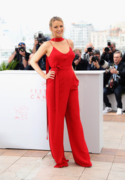 Blake Lively was '70s-chic in a red spaghetti-strap jumpsuit by Juan Carlos Obando at the 'Cafe Society' photocall.