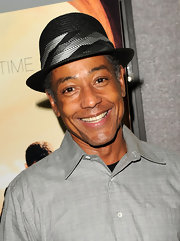 Giancarlo Esposito paired his black fedora hat with a classic grey shirt.