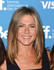 Jennifer Aniston was stylishly coiffed with this layered cut at the 'Cake' press conference.