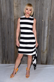 Christina Ricci styled her monochrome frock with a pair of mustard ankle-strap sandals by Calvin Klein.