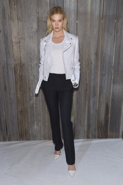 Karlie Kloss was biker-glam in a white leather jacket by Calvin Klein during the brand's Fall 2018 show.