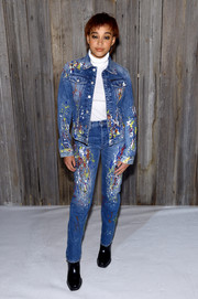 Amandla Stenberg dressed down in a paint-splattered denim suit for the Calvin Klein fashion show.