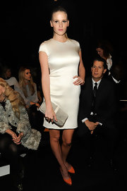 Lara Stone sat front row at the Calvin Klein collection in this shining satin dress.
